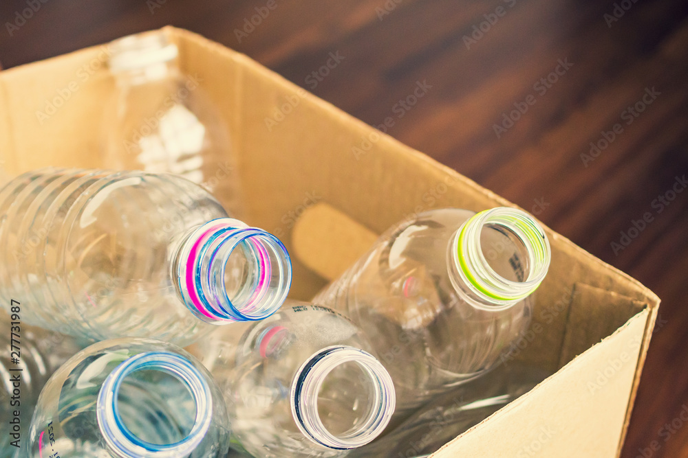 Fototapety, obrazy: plastic bottles in recycling paper box reuse concept