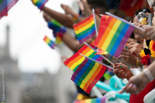 Deurstickers Europa Gay pride, LGBTQ rainbow flags being waved in the air at a pride event