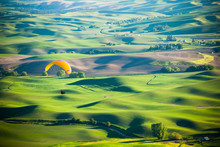 A Man Paragliding Off Steptoe Butte In Eastern Washington State.