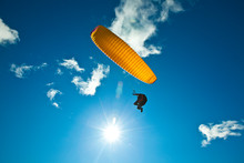 A Male Paraglider Contrasts With The Bluebird Day While Paragliding At Steptoe Butte In Eastern Washington.