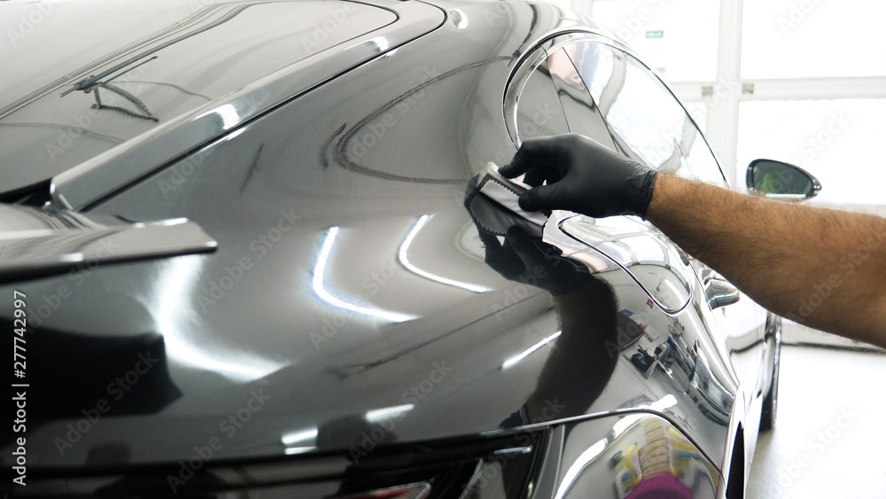 Fototapety, obrazy: Staff wear Chemical protective clothing at work. Automobile industry. Car wash and coating business with ceramic coating.Spraying the varnish to the car. Concept of: Car protective, Service, Shine.