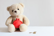 Teddy Bear With Red Wallet, Coins,dollars. Business And Finance Concept/ Financial Support, Business, Family, Alimony, Maintenance, Charity, Investing In Children Concept