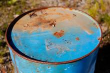 A Blue Rusty Oil Barrel In Nature