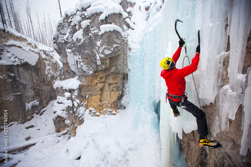 Man ice climbing on rock