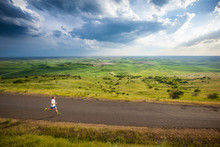 Distance Runner  On A Late Afternoon Run On The Scenic Windy Road Up Steptoe Butte State Park In Eastern Washington State In Peak Spring Conditions.