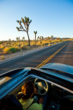 A Woman Drives A Subaru Forester Suv On The Scenic Roads Of Joshua Tree National Park, California.