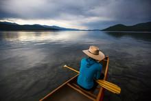 Woman Sitting In Canoe In Priest Lake