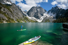 Man Paddleboarding In Colchuck...