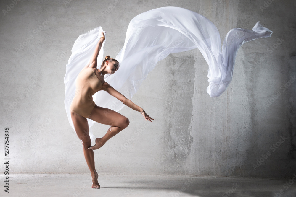 Fototapeta ballet dancer in the work, the dancer with a cloth, a girl with a beautiful body, elegantly girl, graceful woman, lady in dance, athletic body, time show, the girl in flight, wite silk in air, girl,