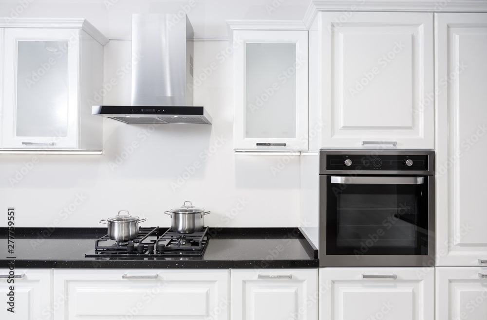Fototapety, obrazy: White glossy kitchen furniture with equipment and pots on a cooker