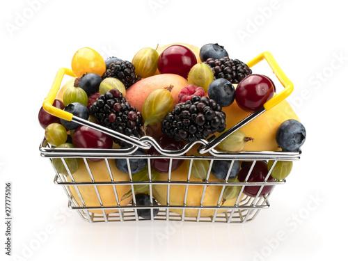 Metal basket filled with fruit - blackberries, apricots, raspberries, blueberries (blueberries), gooseberries, cherries, cherries. On a white background. Still life. Close-up.