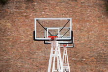 Basketball Court By A Brick Wall Background