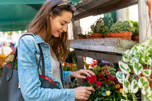 Young Woman On A Flower Market In Barcelona