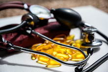 Omega 3 Fish Oil Supplements With Stethoscope And Blood Pressure Cuff