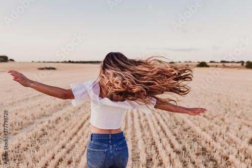 Fotografía Summer Girl enjoying nature on yellow field