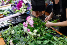 Female Florist Create A Bouquet At Workplace. Floristics Workshop. Making Beautiful Flower Bouquets And Floral Decorations..