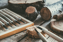 Set Of Woodworking Tools For Wood Carving And Trees Cuts On Wooden Workbench.