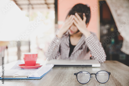 Stressed frustrated young woman employee feeling pain unwell