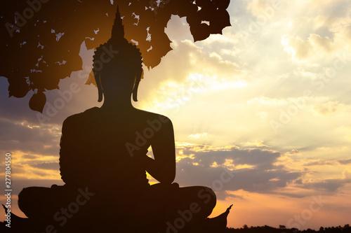 Magha Asanha Visakha Puja Day , Silhouette Buddha on golden sunset background Fototapeta