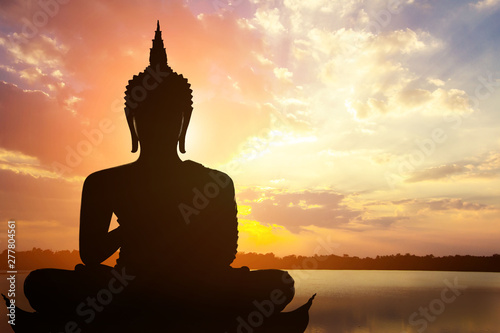 Fotobehang Boeddha Magha Asanha Visakha Puja Day , Silhouette Buddha on golden sunset background.