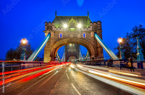 plakat Vehicles pass over Tower Bridge across the River Thames in London, UK.