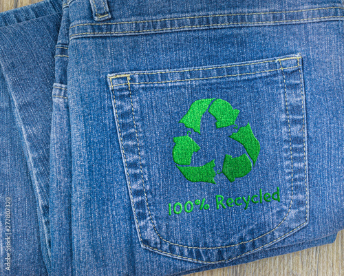 Back pocket of jeans embroidered with recycle textiles logo, concept illustration sustainable fashion recycle clothes and textiles Wall mural