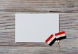 National day of Egypt on 23 July. revolution day. the concept of veterans Day or memorial Day . Egypt glory to the heroes of the war. mini flags with sheets of white paper on white wooden background