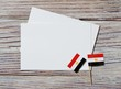 National day of Egypt on 23 July. revolution day. the concept of veterans Day or memorial Day . Egypt glory to the heroes of the war. mini flags with sheets of white paper on white wooden background.