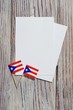 Puerto Rico independence day. day of constitution 25 July. the concept of veterans Day or memorial . mini flags with sheets of white paper on white wooden background.mockup, copy space. vertical