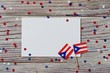 Puerto Rico independence day. day of constitution 25 July. the concept of veterans Day or memorial. mini flags and confetti with sheets of white paper on a white wooden background. mockup, copy space