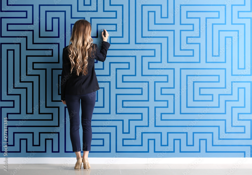 Fototapeta Woman in formal clothes drawing on color wall. Concept of business plan development