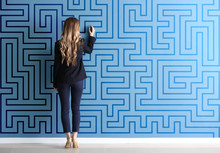 Woman In Formal Clothes Drawing On Color Wall. Concept Of Business Plan Development