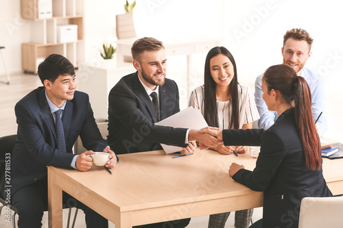 Fotografie, Obraz  Human resources manager shaking hands with applicant after successful interview