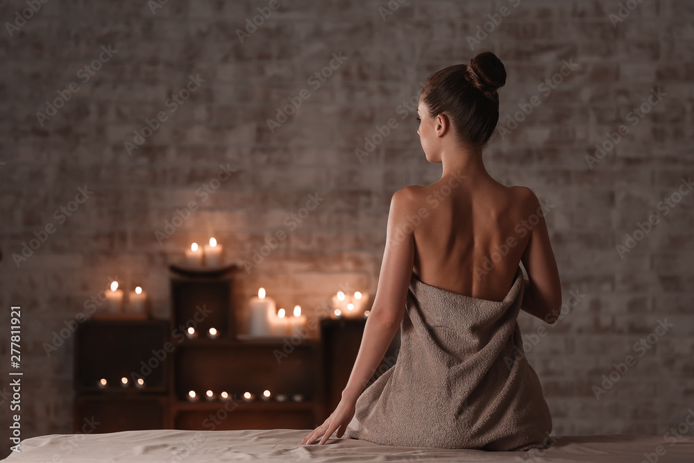 Fototapeta Beautiful young woman relaxing in spa salon