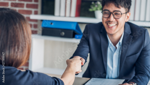 Photo businessman handshake with of interview candidate congraduation for got a  job a