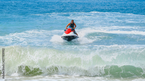 Poster Nautique motorise Man on jet ski jump on the wave