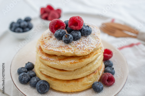 obraz PCV home made sweet vanilla pancakes with berries on a table