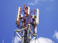 Telecom Tower And Blue Sky Background.