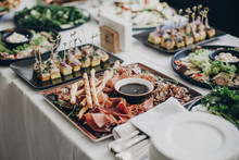 Smoked Meat,sauce,prosciutto, Salad Appetizers On Table At Wedding Or Christmas Feast. Luxury Catering Concept. Delicious Italian Food Table At Wedding Reception.
