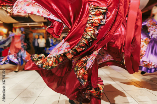 Beautiful gypsy girls dancing in traditional colorful clothing. Roma gypsy festival. Woman performing romany dance and singing folk songs in national dresses at wedding reception - 277831506