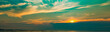 Panorama view of sunset at the beach. Beautiful blue and orange sky and clouds with sunlight. Nature background. Landscape of the beach at tropical sea. Evening sky with peaceful and heaven concept.