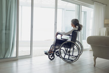 Woman On Wheelchair Looking Outside