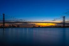 International Ambassador Bridge Over The Detroit River Between United States And Canada. The Bridge Spans Detroit Michigan And Windsor Ontario.
