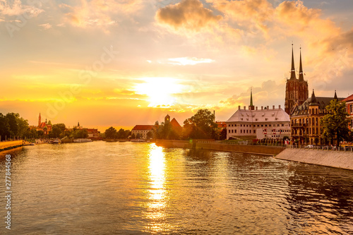 Garden Poster Coral Wroclaw, Poland colorful sunset panorama with Ostrow Tumski island, Odra or Oder river and cathedral towers