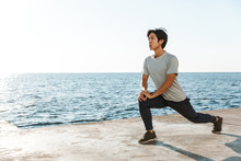Confident Fit Asian Sportsman Exercising Outdoors