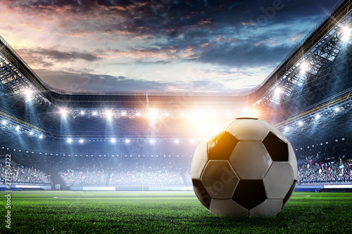 plakat Full night football arena in lights with ball close up