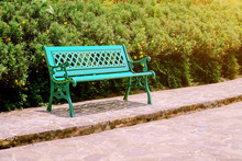 Bench In The Park, Left Corner Stainless Steel Chair In The Garden, Green Tree Background, Relaxation Concept : Long Chair In The Park.