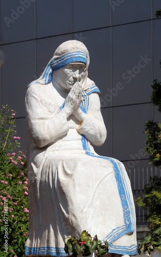 Mother Teresa statue in front St Paul's Cathedral in Tirana, Albania Wallpaper Mural