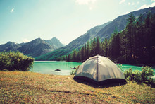 Camping Tent With Lake Background. Rest Or Vacation In The Wild In Siberia In Altai. Outdoor Activity. The Concept Of Hiking