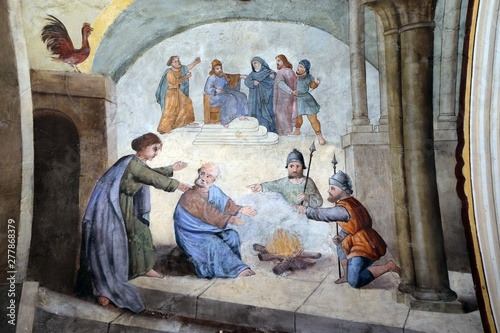 Peter denies Jesus before the rooster crows three times, fresco in the church of Fototapet